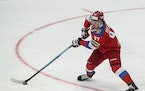 Russia's Kirill Kaprizov controls the puck during the Channel One Cup ice hockey match between Russia and Czech Republic in Moscow, Russia, Saturday,