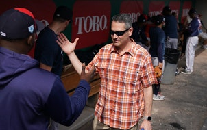 Minnesota Twins Senior Vice President and General Manager Thad Levine greeted third baseman Miguel Sano (22), who sat out of drills again Tuesday and