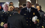 Minneapolis Fire Chief John Fruetel and Assistant Chief Bryan Tyner lined up before processing in to Ron Edwards funeral service Saturday.   ] ANTHONY