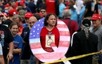 "A supporter of President Donald Trump holds up ""Q"" sign while waiting in line on to see Trump at an August 2018, rally in Wilkes Barre, Pennsylvania."