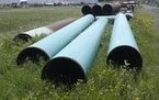 FILE - In this June 29, 2018 file photo, pipeline used to carry crude oil is shown at the Superior terminal of Enbridge Energy in Superior, Wis. An up