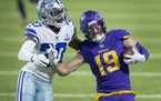 Minnesota Vikings receiver Adam Thielen (19) is pushed out of bounds by Dallas Cowboys' Anthony Brown (30) after a gain of 51 yards on a catch and run