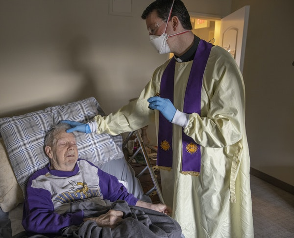 """""""Chuck you are good to go,"""" said Catholic Rev. Andrew Jaspers after he recited the last rites to 85-year-old COVID-19 patient Chuck Schuh, Saturday, D"""