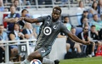 Minnesota United midfielder Kevin Molino (7) kicked the ball as a Colorado Rapids player pursued him during the first half. ]  LEILA NAVIDI • leila.