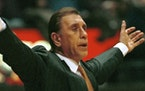 Houston Rockets coach Rudy Tomjanovich coaches against the New Jersey Nets Thursday night, Feb. 18, 1999, in East Rutherford, N.J.  The Rockets beat t