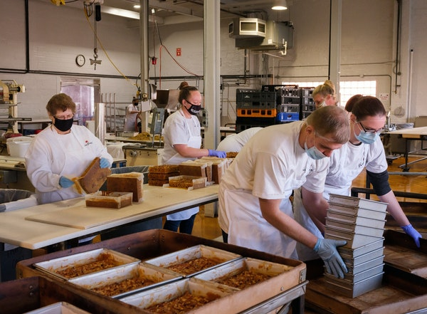 Retailers, such as Beatrice Bakery in Nebraska, strained by a surge in e-commerce and limited by shippers, are facing pressure to deliver gifts on tim