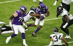 Minnesota Vikings running back Dalvin Cook (33) rushed the ball as Jacksonville Jaguars linebacker Joe Giles-Harris (43) made the tackle in the second