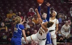 Drake University forward Maggie Bair (42) stopped a shot attempt by Minnesota Gophers guard Gadiva Hubbard (34) in the second half.