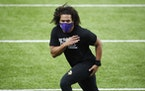 Minnesota Vikings linebacker Eric Kendricks warms up before an NFL football game against the Jacksonville Jaguars, Sunday, Dec. 6, 2020, in Minneapoli