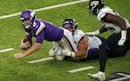 Vikings quarterback Kirk Cousins was sacked by Jacksonville defensive tackle Rodney Gunter