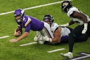 Vikings quarterback Kirk Cousins was sacked by Jaguars defensive tackle Rodney Gunter (99) in the fourth quarter Sunday. Cousins will face even more p