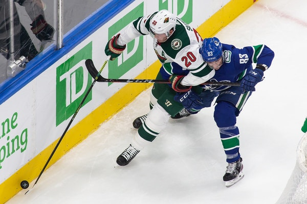 Wild defenseman Ryan Suter (20) battled Vancouver's Jay Beagle as the teams met in an NHL postseason game in Edmonton on Aug. 2. The Wild's season