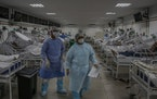 Nurses work at a field hospital for COVID-19 patients in Manaus, Brazil, in May.