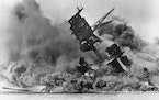 Smoke rises from the battleship USS Arizona as it sinks during a Japanese surprise attack on Pearl Harbor, Hawaii, on Dec. 7, 1941.