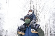 Glenn Simmons Jr. carried his son Kai, 2, atop his shoulders during an outing in Bagley Nature Area in Duluth. The group has met weekly for about thre