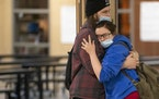Gavin Lawrence embraced his girlfriend, Chace Johnson, in between classes at South Ridge School. It is one of only a few school buildings in Minnesota