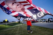Randal Thom of Lakefield, Minn., walked to the highway to wave Trump flags with supporters during the August primary election.