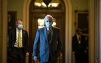 Senate Majority Leader Mitch McConnell, R-Ky., walks to his office from the Senate floor of the Capitol on Dec. 3.
