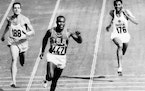 In this Sept. 5, 1960, file photo, Rafer Johnson of the United States, center, finishers the fourth heat of the decathlon 100 meter dash at the Olympi