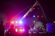 Firefighters battled a multiple-alarm industrial fire at a warehouse on Bass Lake Road on Tuesday in Maple Grove.