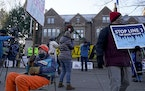 Protesters demonstrate outside the governor's residence about the adequacy of Enbridge's virus plans.
