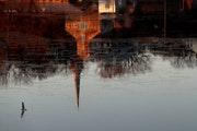 Instead of sitting out the pandemic winter, Stillwater — reflected Tuesday in the St. Croix River — has decided to decorate and plan low-key outdo