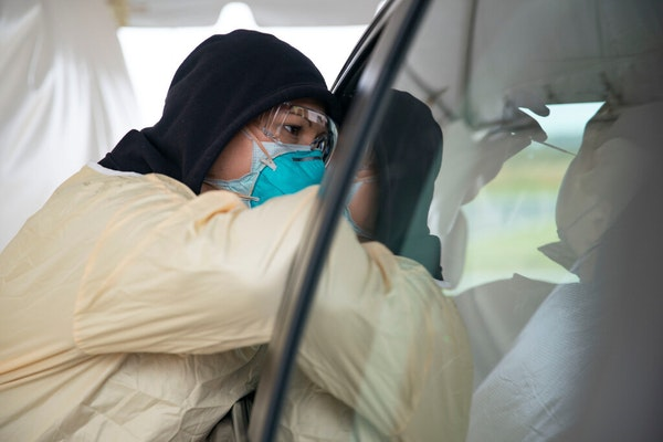 Cheryl Odegaard, a medical assistant at St. Luke's Respiratory Clinic, administered a COVID-19 test to a patient in their drive-through testing site