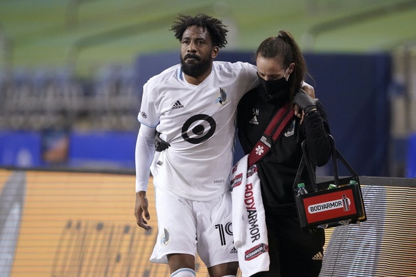 Minnesota United's Romain Metanire was helped from the pitch Monday night after being injured in the first half. He did not return.