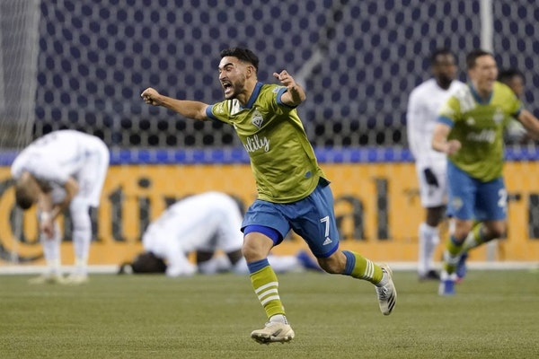 Seattle Sounders' Cristian Roldan (7) celebrates a Sounders goal late in the second half of an MLS playoff Western Conference final soccer match again