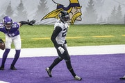 Vikings wide receiver Justin Jefferson celebrated his 20-yard touchdown catch in the third quarter as Jaguars free safety Jarrod Wilson, center, and J