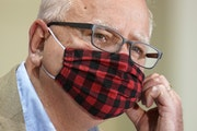 Minnesota Gov. Tim Walz wore his buffalo plaid cloth mask at a July 22 news conference. He thanked Minnesotans on Monday for a recent hike in mask-wea