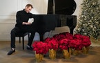 """Pianist Phil Thompson organizes """"A Minnesota Holiday,"""" a compilation of musicians playing seasonal songs, which raises money for charity. This yea"""