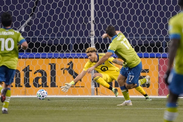 Seattle Sounders forward Will Bruin (17) watches his shot go past Minnesota United goalkeeper Dayne St. Clair as he scores during the second half of a