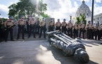 State troopers surrounded the toppled statue of Christopher Columbus at the Minnesota Capitol in June.