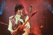 """Prince performs in his debut movie """"Purple Rain,"""" the 1984 rock opera about a young man's search for artistic accomplishment and love."""