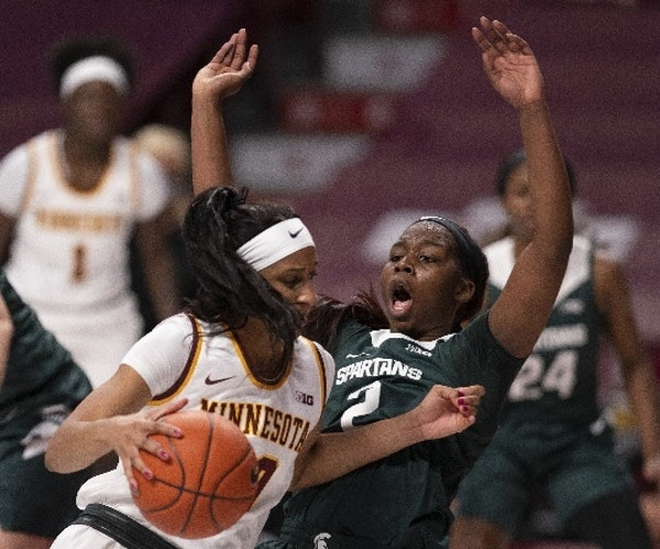 Gophers forward Kadi Sissoko earned a charging foul by driving into Michigan State forward Mardrekia Cook (2) in the first quarter Wednesday night.