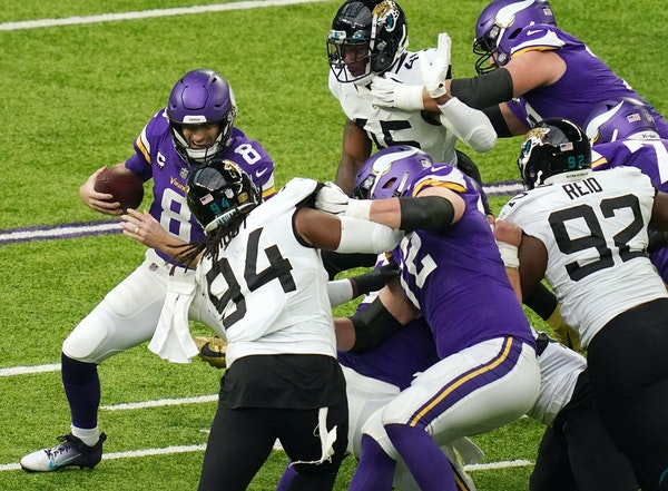Vikings quarterback Kirk Cousins scrambled as the pocket around him collapsed in the second quarter against the Jaguars on Sunday.