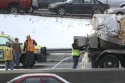 The milk truck truck involved in an accident was towed to the side of the road as the rest of the milk  was drained out near the Lowry tunnel in Minne