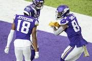 Vikings tight end Irv Smith Jr., right, celebrates a touchdown with teammates Justin Jefferson  and Adam Thielen on Nov. 8.