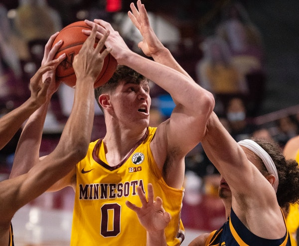 Gophers center Liam Robbins tried to get a first-half shot off in heavy traffic. He had 14 points at halftime and finished with 27.
