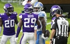 Detroit Lions running back Kerryon Johnson (33), right, and Minnesota Vikings defensive back Kris Boyd (29) argue in the fourth quarter during an NFL