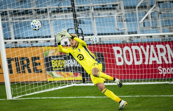 Loons keeper Dayne St. Clair stopped a shot during a playoff game in October.