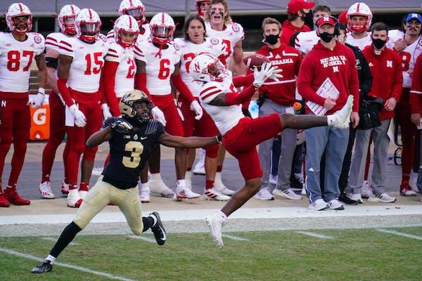 Nebraska cornerback Cam Taylor-Britt (5) breaks up a pass intended for Purdue wide receiver David Bell (3) last week.