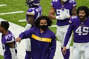 Minnesota Vikings middle linebacker Eric Kendricks (54), who didn't play Sunday after inflaming his injured calf during warmups, gave a pat on the s