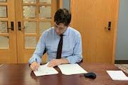Mayor Jacob Frey signs the 2021 budget Friday.