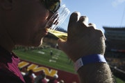 Gophers fan D.J. Anderson of White Bear Lake enjoyed a beer from near the endzone in 2012.