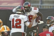 Tampa Bay Buccaneers wide receiver Tyler Johnson celebrates with quarterback Tom Brady (after Johnson caught a 2-yard touchdown pass against the Green