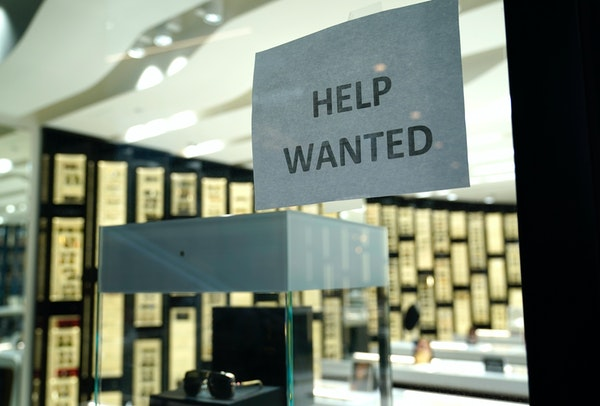 A Help Wanted sign is posted at a Designer Eyes store in Miami.