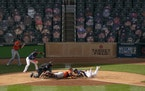 Twins second baseman Luis Arraez was tagged out at home during the team's two-game playoff series with Houston a Target Field. The Twins played thei