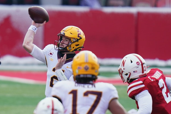 Gophers quarterback Tanner Morgan threw a pass during the first half of Saturday's game at Nebraska.